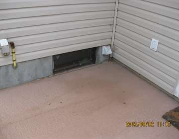 Leaking basement window - improper grade