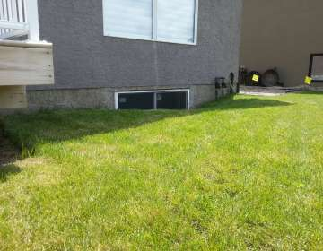 Leaky foundation & basement windows due to improper grade and landscaping